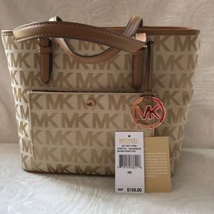 Michael Kors purse Cam/Dk tan Jet set item